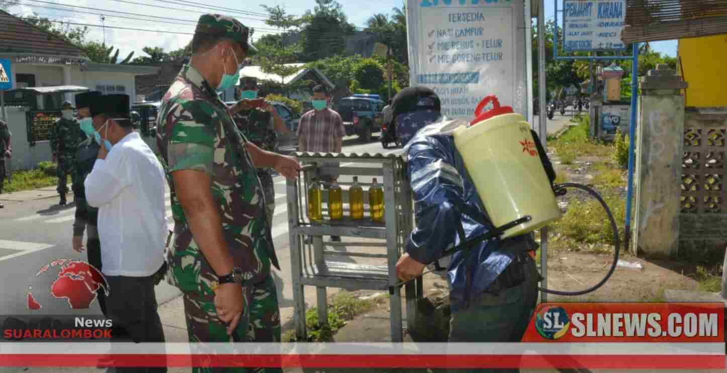 TNI Semprot Disinfektan di Lombok Barat