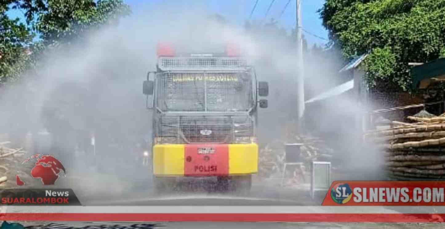 Bersama Perang Melawan Corona, Polisi Kepung Desa Bagu Dengan Disinfektan