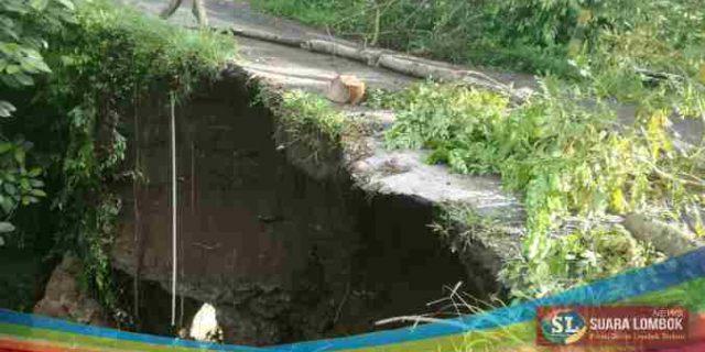 Jembatan Tandak – Andak Amruk, Objek Pariwisata Air Terjun Benang Stokel Terisolir